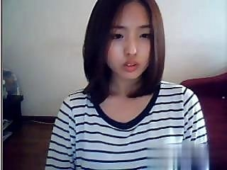 Asian bitch has a hot webcam front to perform convenient