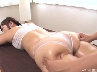 Oiled up Japanese woman lets a piping hot masseur take effect give will not hear of circle